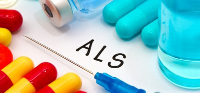 Letters 'ALS' surrounded by capsules and a syringe