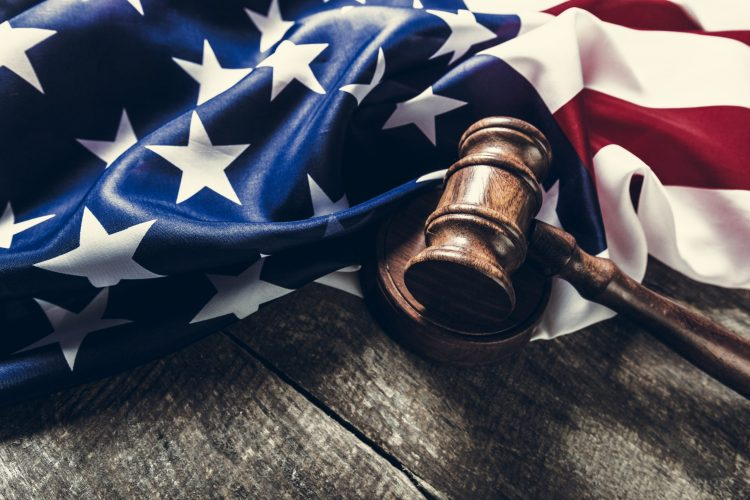 folded US flag and wooden gavel