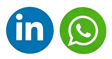 The social media symbols for LinkedIn and WhatsApp