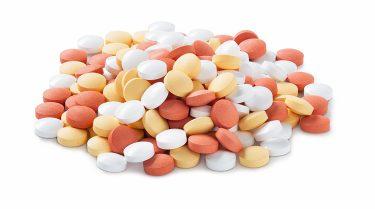 Pile of orange and white pills