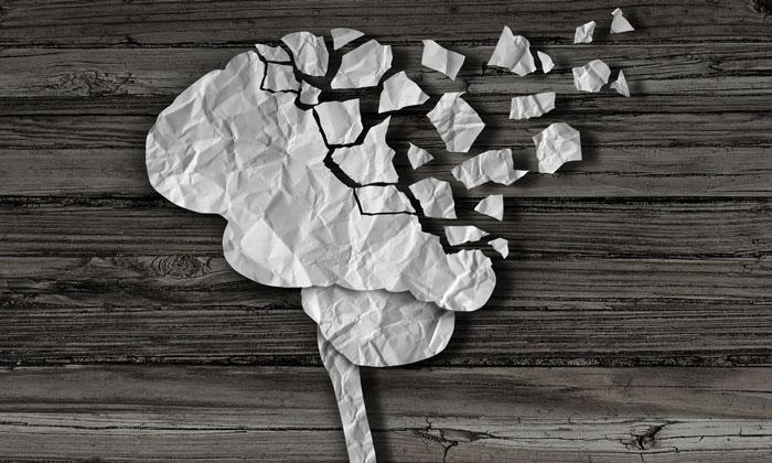 diagram of a brain discintegrating into small pieces