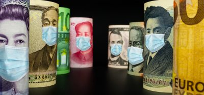 various currency notes with facemasks on the pictures of the leaders