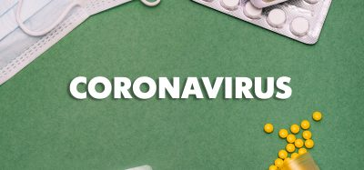 the word 'coronavirus' surrounded by tablets and a face mask
