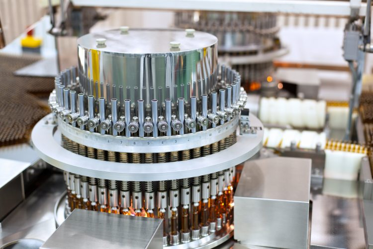 Automatic optical inspection machine, inspects vials and ampules for particulates in liquid