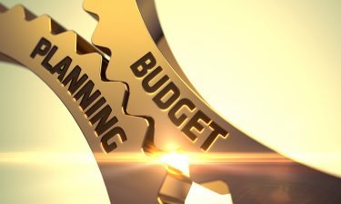 interlocking cogs labelled with 'budget' and 'planning'
