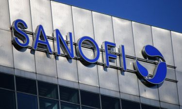 Sanofi logo on side of office building