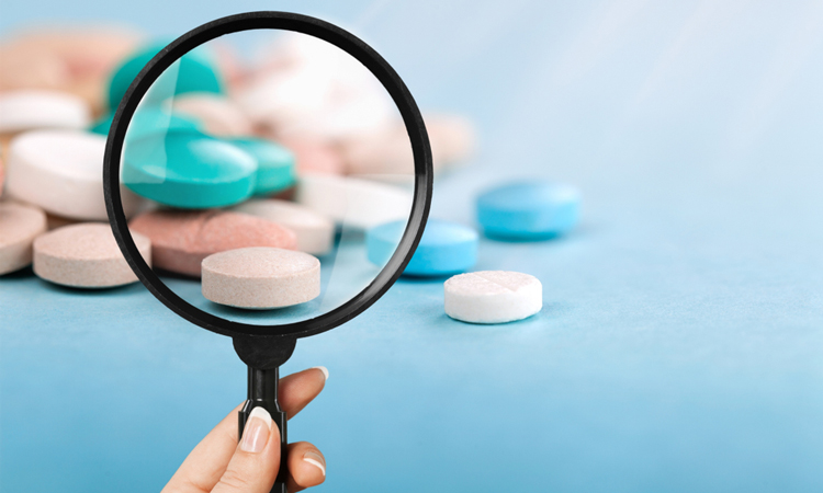 Magnifying glass on pills