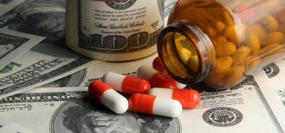 Pills and bottle split on dollars
