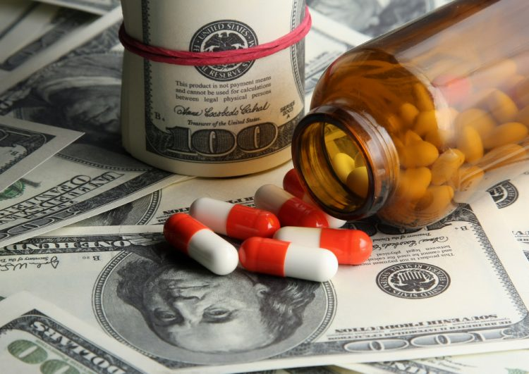 Pills and bottle split on dollars