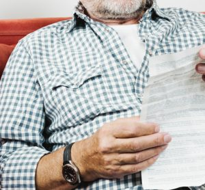 Man with patient information leaflet