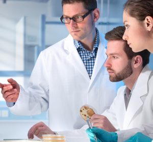 Scientists in lab looking at a computer