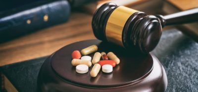 Pills near gavel