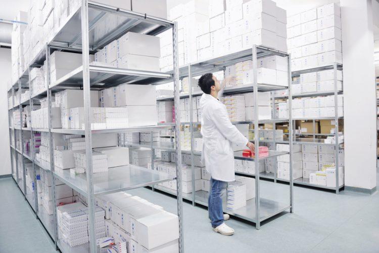 Worker in medicine warehouse
