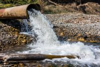 wastewater pipe releasing water into a stream